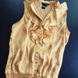 Gold sleeveless blouse